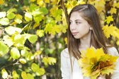 Portrait in autumn park — Stock Photo