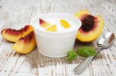 Yougurt with peaches — Stock Photo