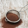 Sieve with cocoa powder — Stock Photo #57534455