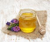 Honey with flowers — Stock Photo