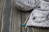 Knitting on rustic wooden background — 图库照片
