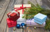 Christmas trees with heap of gift boxes — Stock Photo
