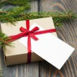 Vintage gift box package with blank tag — Stock Photo #58488439