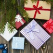 Christmas trees with heap of gift boxes — Stock Photo #58695433