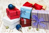 Christmas baubles  with heap of gift boxes — Стоковое фото