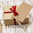 Vintage gift box package with blank tag — Stock Photo #59005809