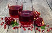 Two glasses of pomegranate juice — Zdjęcie stockowe