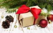 fir tree with gift — Stock Photo