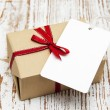 Vintage gift box package with blank tag — Stock Photo #59427343