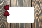 Two hearts and greeting card — Stock Photo