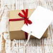 Vintage gift box package with blank tag — Stock Photo #60325035