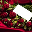 Red rose and greeting card — Stock Photo #60841651