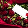 Red rose and greeting card — Stock Photo #61503223