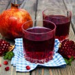 Two glasses of pomegranate juice — Stock Photo #61759059