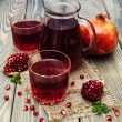 Pitcher and Two glasses of pomegranate juice — Stock Photo #61979955