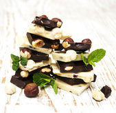 Dark and white chocolate with nuts — Stock Photo