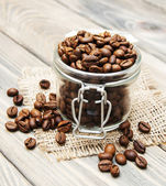 Glass jar full of coffee beans — Stock Photo