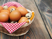 Different types of eggs in a basket — Stock Photo