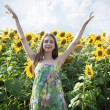 Beautiful girl with sunflower — Stock Photo #68513527