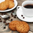 Cup of coffee and oatmeal cookies — Stock Photo #73135259
