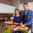 Couple in home kitchen prepairing healthy food — Stock Photo #54971891