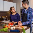 Couple in home kitchen prepairing healthy food — Stock Photo #56716107