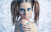 Beautiful model with pigtails, fancy makeup and blue manicure — Stock Photo