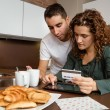 Couple with electronic tablet and credit card buying online — Stock Photo #59609811