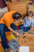 Father and son assembling a new furniture for home — Stockfoto
