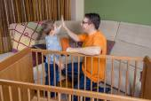 Father and son giving five for success in a home work — Stock Photo