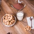 Chocolate chip cookies and milk on wood background — Stock Photo #60651413