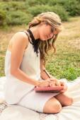 Romantic girl writing in a diary sitting outdoors — Stock Photo