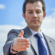 Business man with his open hand ready for seal a deal — Stock Photo #61273501