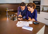 Couple reviewing their accounts with a digital tablet — Stock Photo