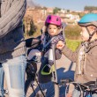 Lttle girl with helmet on head sitting in bike seat — Stock Photo #65142771