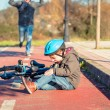 Boy with knee injury after falling off to bicycle — Stock Photo #66078077