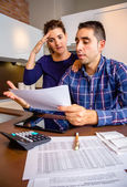 Unemployed young couple with debts reviewing their bank accounts — Stock Photo