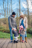 Happy family enjoying together leisure in the forest — Foto de Stock