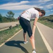 Athletic woman suffering pain in leg calf by cramp — Stock Photo #70994689