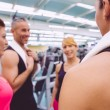 Women talking with personal trainer after training day — Stock Photo #72085757
