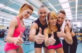 Friends whit thumbs up smiling after a training day — Foto de Stock