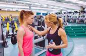 Personal trainer encouraging to sad woman after the training — Stock Photo