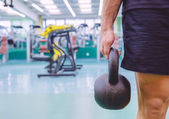 Man holding kettlebell in a crossfit training — Stock Photo