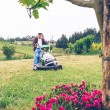 Senior man mowing the lawn with lawnmower — Stock Photo #72649039