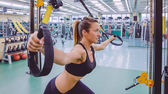 Woman doing suspension training with fitness straps — Stock Photo