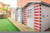 Beach striped huts in a home garden — Stock Photo