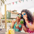 Young women couple drinking healthy drinks outdoors — Stock Photo #77467620