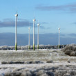 Beautiful cold winter landscape with wind generators on background — Stock Photo #62176345