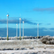 Beautiful cold winter landscape with wind generators on background — Stock Photo #62176357