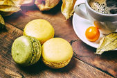 Cup of black coffee with French macaroons — Stock Photo